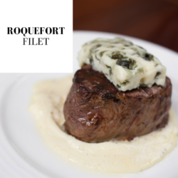 plated filet with Roquefort sauce and cheese.